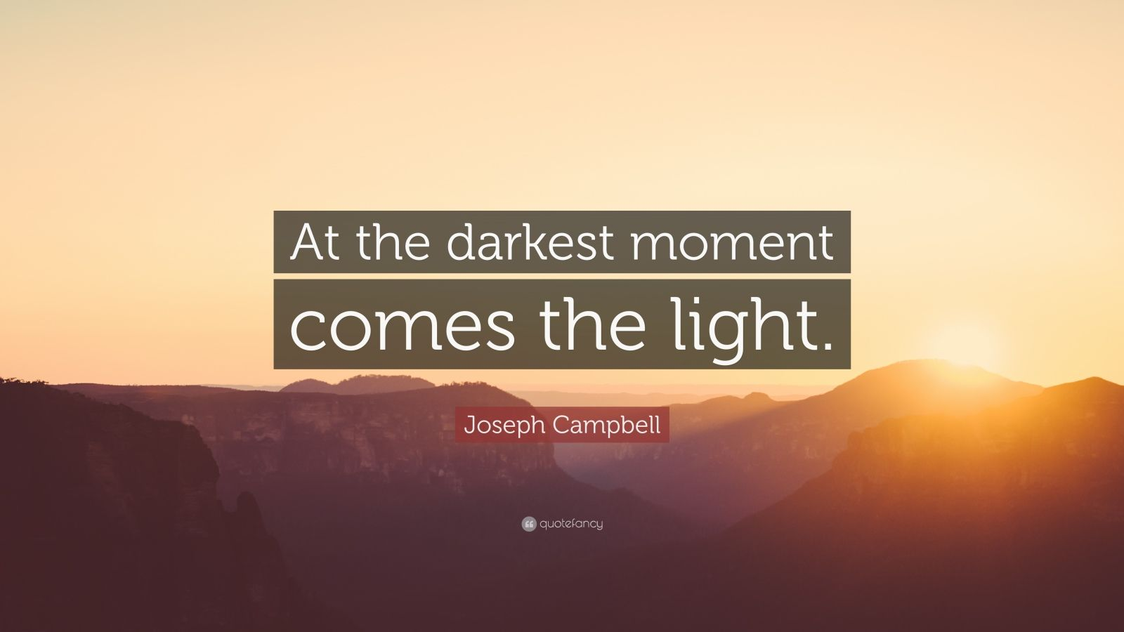 """Joseph Campbell Quote: """"At the darkest moment comes the light."""""""