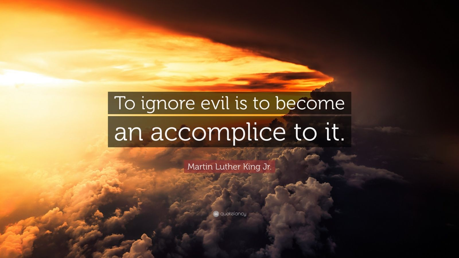 """Martin Luther King Jr. Quote: """"To ignore evil is to become an accomplice to it."""""""
