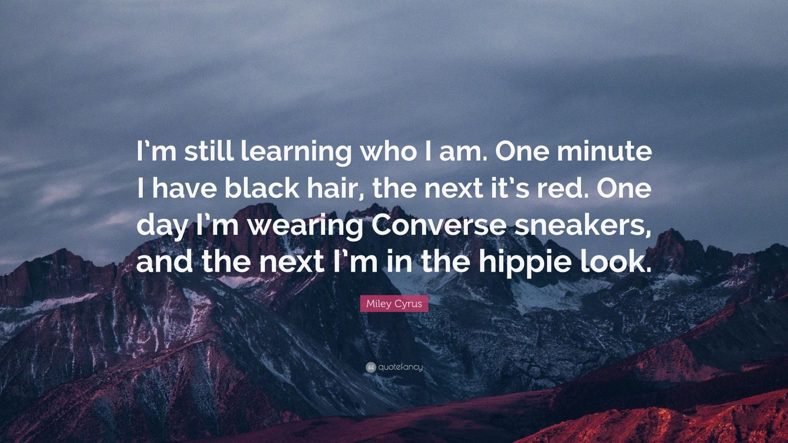 """Miley Cyrus Quote: """"I'm still learning who I am. One minute I have black hair, the next it's red. One day I'm wearing Converse sneakers, and the next I'm in the hippie look."""""""