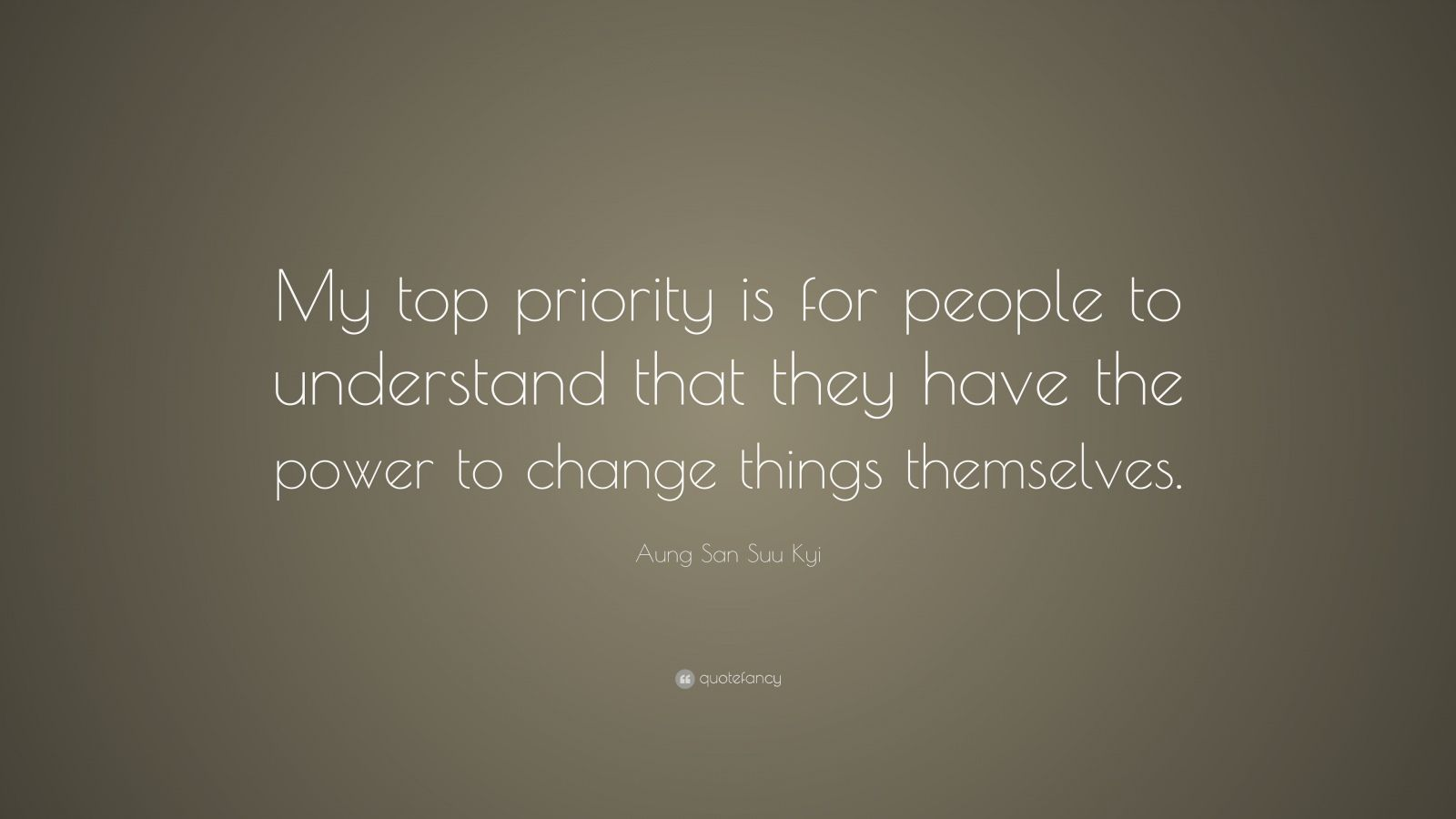 "Aung San Suu Kyi Quote: ""My top priority is for people to understand that they have the power to change things themselves."""