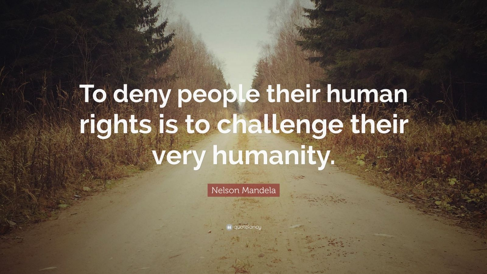 "Nelson Mandela Quote: ""To deny people their human rights is to challenge their very humanity."""