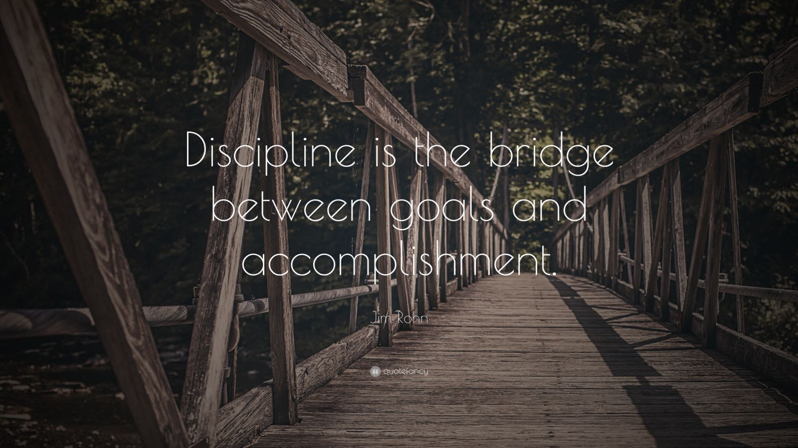 "Jim Rohn Quote: ""Discipline is the bridge between goals and accomplishment."""